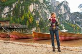 pic of south tyrol  - Full length portrait of young woman on lake braies in south tyrol italy - JPG