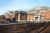 stock photo of playground school  - Focus on playground equipment at an elementary school - JPG
