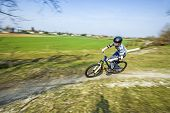 foto of dirt-bike  - Teenage Boy Racing With His Dirt Bike - JPG