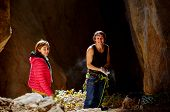 pic of cave woman  - couple of  climbers standing in a cave - JPG