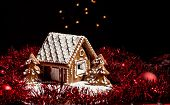 stock photo of gingerbread house  - Holiday Gingerbread house on dark background christmas cookie - JPG