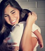 picture of family love  - Closeup portrait of cute smiling mother holding on hands little baby - JPG