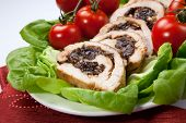 stock photo of butter-lettuce  - Delicious turkey breast roulade cut in slices stuffed with prunes and almond - JPG