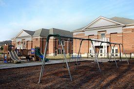 stock photo of playground school  - Focus on playground equipment at an elementary school - JPG