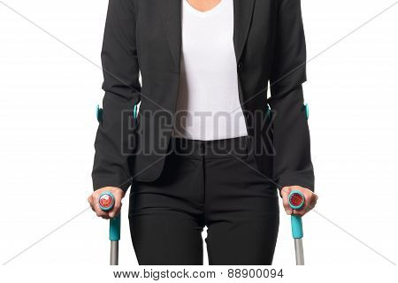Disabled Businesswoman Walking With Two Crutches