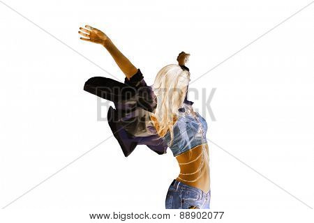 young woman in motion with arms up, inverted colors