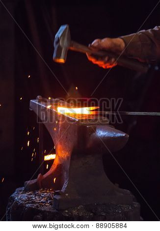 Blacksmith Hammering A Hot Metal Rod
