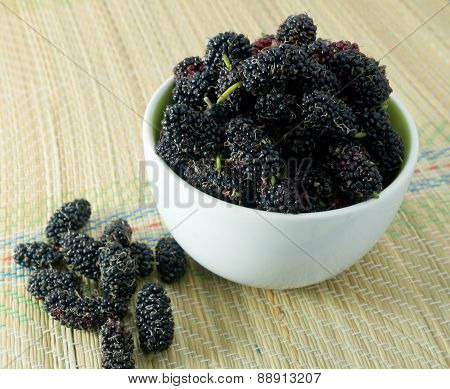 Fresh Mulberry In A Bowl On Straw Mat