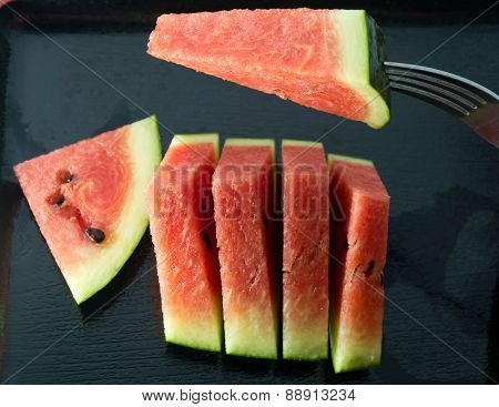 Delicious Sliced Of Watermelon On A Black Tray