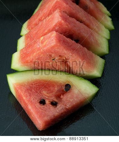 Sliced Of Watermelon On A Black Tray