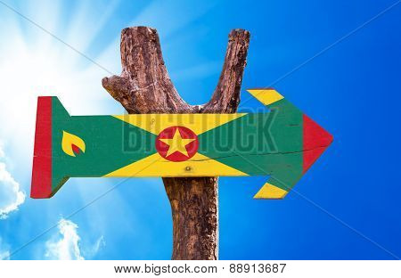 Grenada Flag wooden sign with sky background