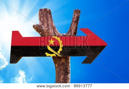 Angola Flag wooden sign with sky background
