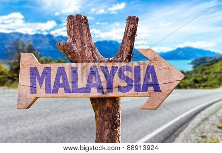 Malaysia wooden sign with road background