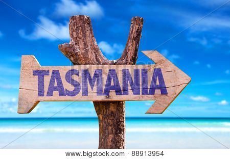 Tasmania wooden sign with beach background