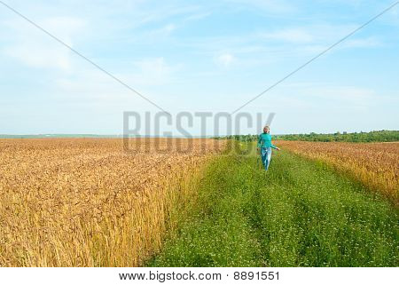 Girl Running Across The Field
