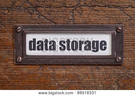 data storage  - file cabinet label, bronze holder against grunge and scratched wood