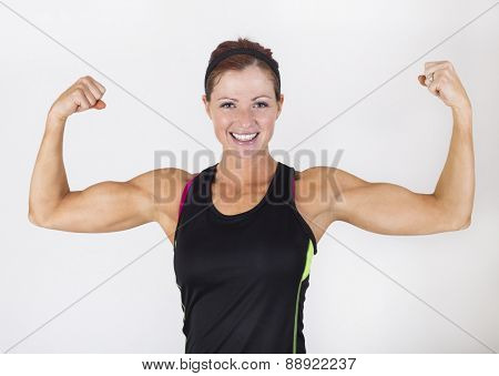 A strong muscular woman flexing her muscles.  Beautiful woman Isolated on a white background