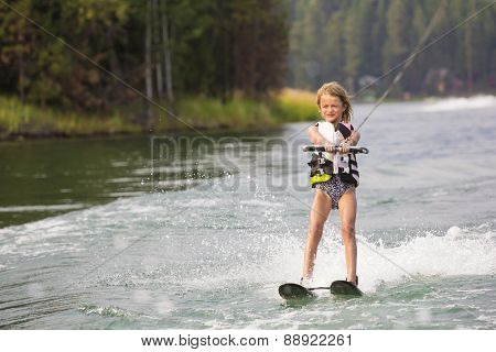 Young Waterskier water skiing on a beautiful scenic lake
