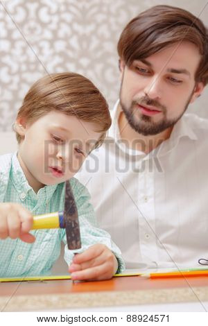 Father and boy with hammer