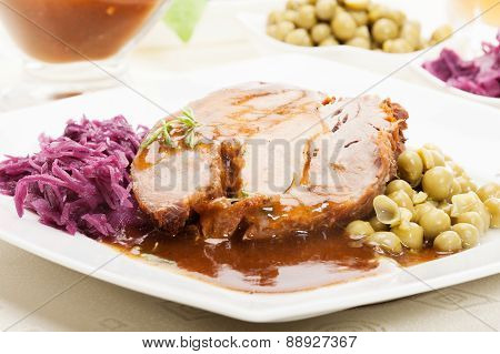 Roast pork with sauce and vegetables