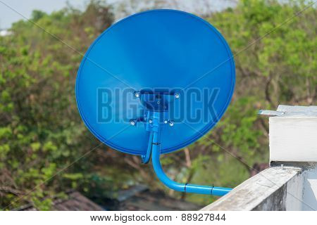 Blue Satellite TV Receiver Dish on the roof