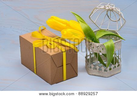 Gift Box And Yellow Tulips In Decorative Cage