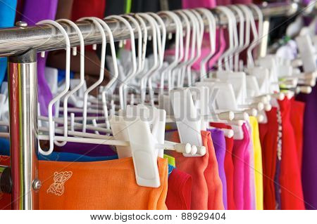 Row Of Colorful Skirt With White Clothes Hanger