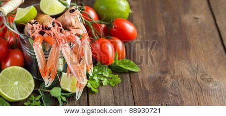 Raw Langoustine In A Bucket And Vegetables