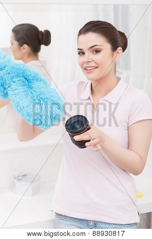 Young lady acts like cleaning object-glass