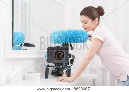Young-looking lady posing with cleaning sweep