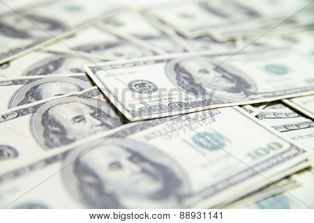 Stack of US Dollars isolated over white background.