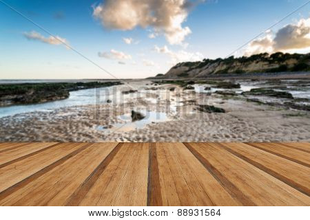 Summer Landscape With Rocks On Beach During Late Evening And Low Sunlight With Wooden Planks Floor