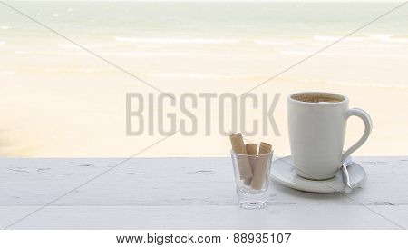 Coffee Cup With Crispy Snack By The Beach