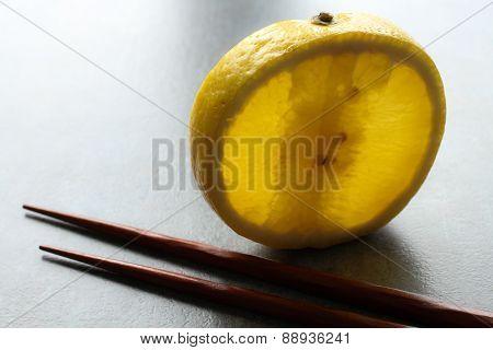 A Slice Of Lemon On A Gray Background