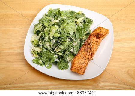 Caesar Salad With Salmon On Square Plate