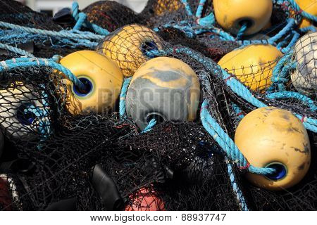 Isolated Fishing Net Pile With Yellow Floats