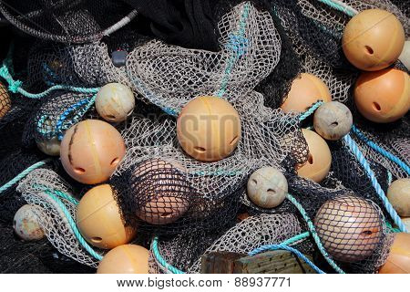 Background Of Fishing Net Pile With Yellow Floats