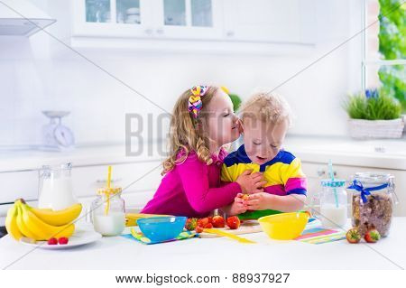 Kids Preparing Breakfast In A White Kitchen