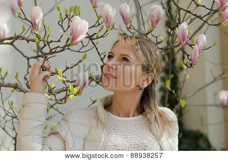 Young woman with magnolia flowers