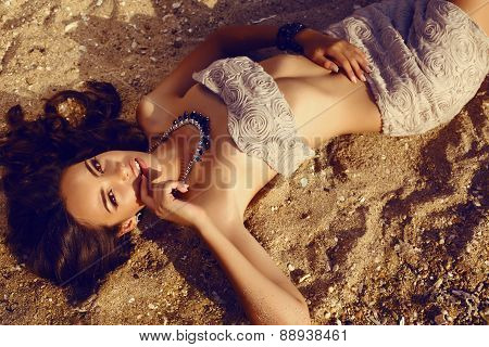 Girl With Dark Hair In Elegant Dress Relaxing On Summer Beach
