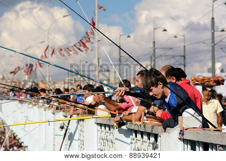 People on the Galata Bridge, Istanbul, Turkey.
