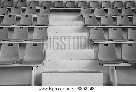 Old sport tribune with empty chairs