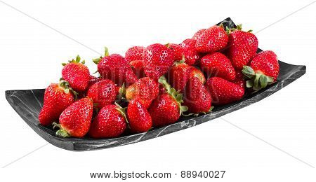 Tasty  strawberries freshly collected in a wooden plate isolated on white background