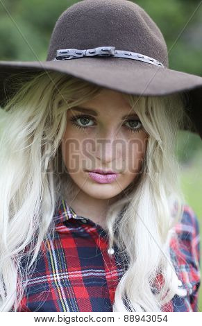 Beautiful Healthy Young Woman Outdoors Wearing Big Floppy Hat