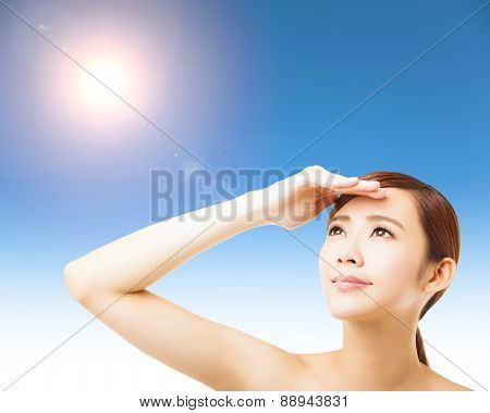 Young Woman Face With Sunlight Background