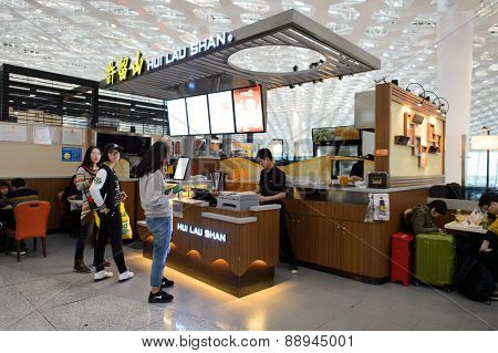 SHENZHEN, CHINA - FEBRUARY 16, 2015: Shenzhen Airport food court. Shenzhen Bao'an International Airport is located near Huangtian and Fuyong villages in Bao'an District, Shenzhen, Guangdong
