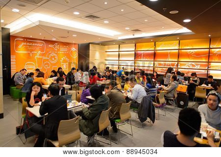 SHENZHEN, CHINA - FEBRUARY 16, 2015: KFC restaurant interior. KFC is a fast food restaurant chain that specializes in fried chicken and is headquartered in Louisville, Kentucky, in the United States