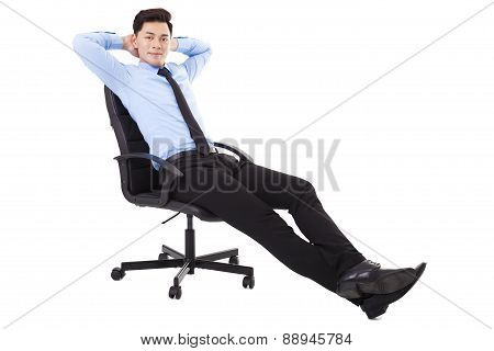 Relaxed Young Businessman Sitting In A Chair Isolated
