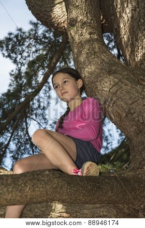 Girl daydreaming in the old tree