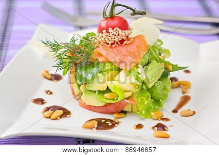 Round Shaped Smocked Salmon Salad With Avocado Decorated With Cherry Tomato And Tested Pine Nuts, On